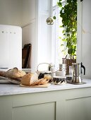 Sliced bread, coffee and everything for breakfast on the kitchen counter