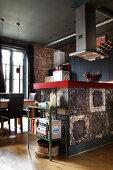 Vintage kitchen island with chicken wire in an open kitchen