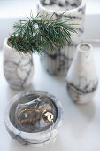 Marble vases and bowl with Christmas decorations