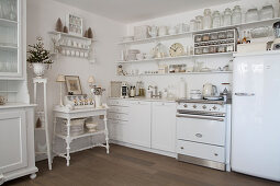 Vintage decorations in white shabby-chic kitchen