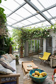 Lounge furniture on roofed terrace in summer