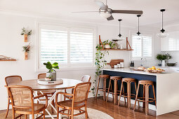 Round table and chairs next to kitchen counter