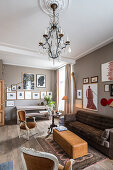 Chandelier in classic living room in shades of brown