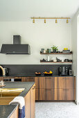 Elegant, custom kitchen and island counter with wooden fronts