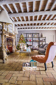 Living room in renovated farmhouse decorated for Christmas
