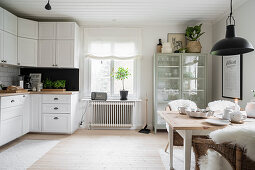 Large kitchen-dining room in Scandinavian country-house style