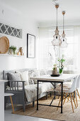 Industrial-style table and old, grey kitchen bench in Scandinavian dining room
