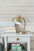 Silver vintage-style lamp on bedside table