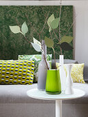 Urban Jungle accessories: wall hanging, cushions and faux branches in vase