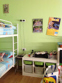 Bunk beds and storage solution with pull-out boxes in green sibling's bedroom