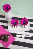 Anemones in egg cups decorating table
