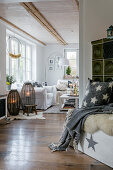 Green tiled stove in shabby-chic living room with autumnal decorations