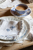 Breakfast table set with coffee and monogrammed napkin