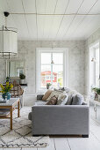 Ornate wallpaper in classic living room in shades of grey