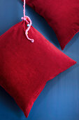 Hand-sewn red corduroy cushion covers