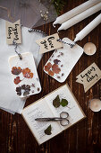 Gift tags and handmade scented wax tablets with flowers and leaves