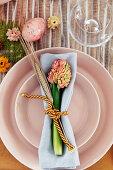 Hyacinth, ear of barley and napkin on pink plates