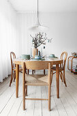 Table set for Easter and bistro chairs in dining room