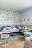 Twin beds arranged in L used as sofas in children's bedroom