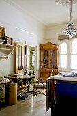 Antique corner cabinet and sewing machine in elegant room