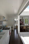 Kitchen and dining area adjoining terrace