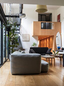 Lounge in loft apartment with gallery