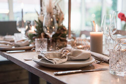 Place settings in natural shades on wedding table