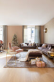 Elegant living room decorated in pink, gold and mauve at Christmas