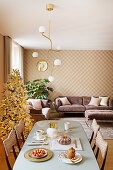 Elegant interior decorated in pink, gold and mauve at Christmas