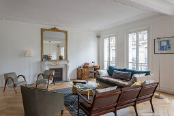 Mid-century modern furniture in living room of French period building