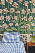 Water lilies painted on wall of vintage-style bedroom