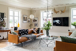 Cognac leather sofas in classic living room