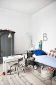 Bed, table and chair and Industrial-style wardrobe in teenager's bedroom