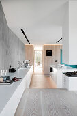 Sideboard in sunken, open-plan kitchen in architect-designed house