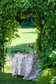 Romantically set tea table in summery château garden