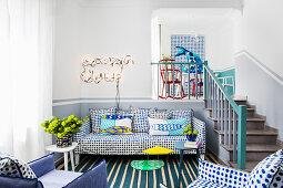 Blue-and-white polka-dot sofa set next to steps in split-level interior