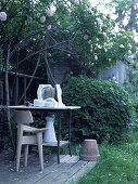 Artist's workplace in shade below climbing rose