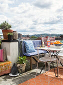 Fruit and drinks on table and benches and chairs on roof terrace