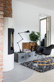 Rocking chair in front of Industrial-style, low sideboard in living room