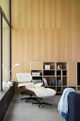 Eames Lounge Chair in modern interior with wood-panelled wall