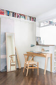 Desk and designer chair in open-plan study