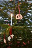 Christmas-tree decorations in shape of pretzel and pig