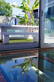 Glass floor next to open door and view of table on terrace
