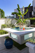 White table with glass insert on terrace