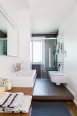 Elongated bathroom with different floor levels