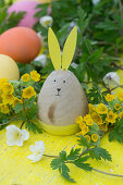 Easter bunny and Easter eggs with cowslip and wood anemone