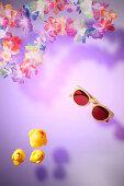 Summer feeling: Hawaiian lei and sunglasses and rubber ducks