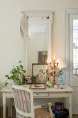 Shabby-chic desk with mirror and vintage-style ornaments