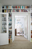 Fitted bookcase surrounding doorway leading into bedroom