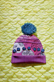 Composition of materials and fabrics in shape of a bobble hat